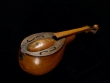 This gourd banjo is from the 1800s. African American